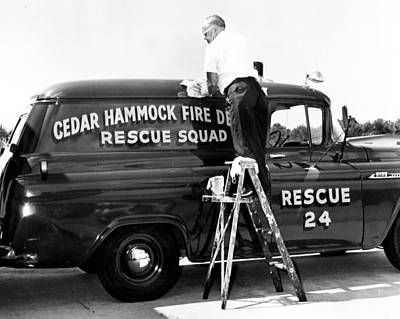 Fire Department Photograph - Cleaning The Old Fire Truck by Retro Images Archive
