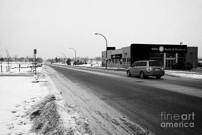 cleared salted gritted road in commercial district of Saskatoon Saskatchewan Canada Art Print