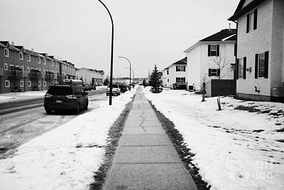 cleared salted gritted sidewalk in a residential development Saskatoon Saskatchewan Canada Print by Joe Fox