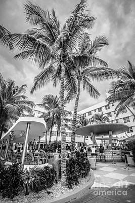 Poolside Photograph - Clevelander Hotel Illuminated Palms Sobe Miami Florida - Black And White by Ian Monk
