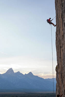 Photograph - Climber Rappelling Down Boulder by Ben Horton