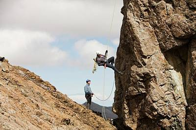 Climbing In Photograph - Climbers Abseiling by Ashley Cooper