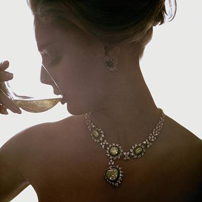 Wine Photograph - Close Up Of A Young Woman Wearing Jewelry by Bert Stern