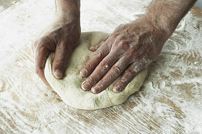 Mess Photograph - Close-up Of Hands Kneading Dough by Bruno Crescia
