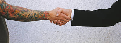 Images Of Hands Photograph - Close-up Of Two Men Shaking Hands by Panoramic Images