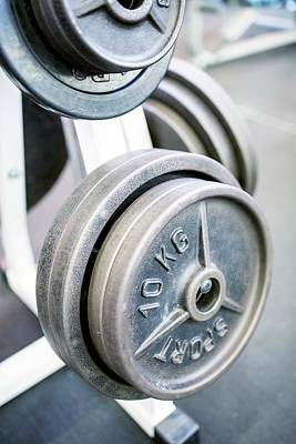 Close-up Of Weight Plates Art Print by Science Photo Library