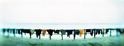 Varanasi Photograph - Clothes Drying At The Riverbank, Ganges by Panoramic Images
