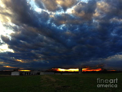 Clouds At Sunset Art Print by Lisa Holmgreen