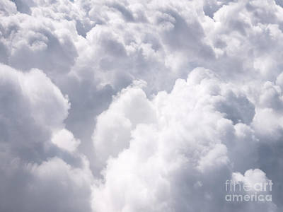 Puffy Photograph - Clouds From Above Background by Paul Velgos