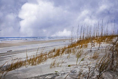 Clouds Over The Dunes Art Print by Debra and Dave Vanderlaan