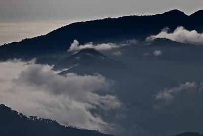 Photograph - Clouds Over The Mounatins by Brian Magnier
