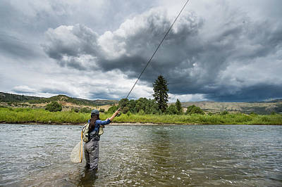 Colorado Fly Fishing River Wall Art - Photograph - Clouds Over Women Fishing In River by Jennifer Magnuson