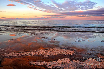 Clouds Reflections On Rock Beach Art Print by Charline Xia