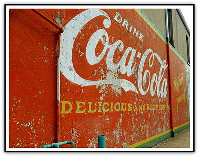Art Print featuring the photograph Coca-cola On The Army Store Wall by Kathy Barney