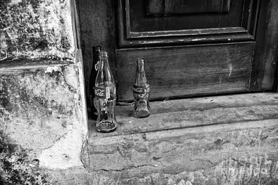 Photograph - Coke Bottles On The Stoop Mono by John Rizzuto