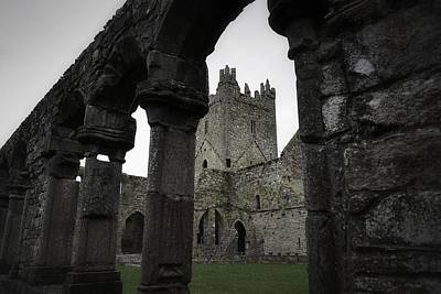 Photograph - Colonnade And Tower Of Jerpoint Abbey by Nadalyn Larsen