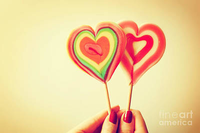 Love Photograph - Colorful Heart Shaped Lollipops In Woman Hand by Michal Bednarek