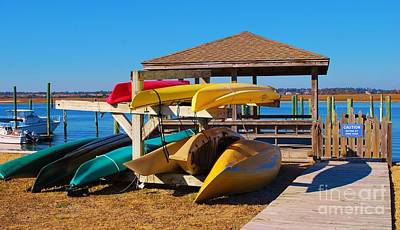 Photograph - Colorful Kayaks And Canoes by Bob Sample