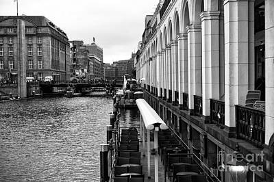 Photograph - Columns Along The Hamburg Canal Mono by John Rizzuto