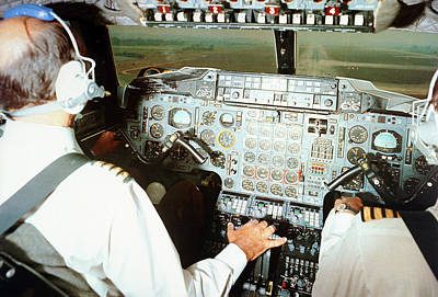 Airliners Photograph - Concorde Pilots In Cockpit by Us National Archives