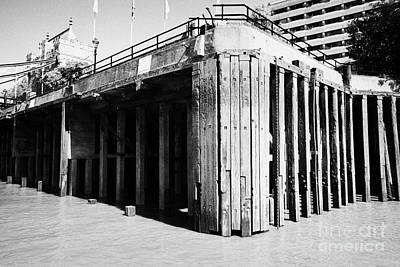 concrete piles and wooden stanchions on thames riverbank London England UK Art Print by Joe Fox