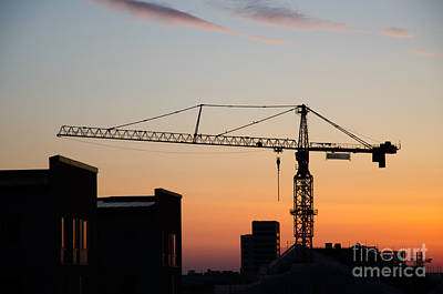Photograph - Construction Crane By Roofs At Sunrise  by Kennerth and Birgitta Kullman
