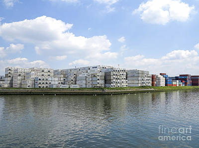 Photograph - Containers Stacked On Waterfront In Harbor Rotterdam by Patricia Hofmeester