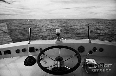 Controls On The Flybridge Deck Of A Charter Fishing Boat In The Gulf Of Mexico Out Art Print by Joe Fox