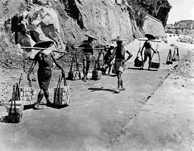 Brick Building Photograph - Coolies Carrying Bricks by Underwood Archives