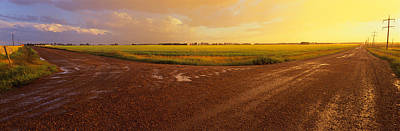 Dirt Roads Photograph - Country Crossroads Passing by Panoramic Images