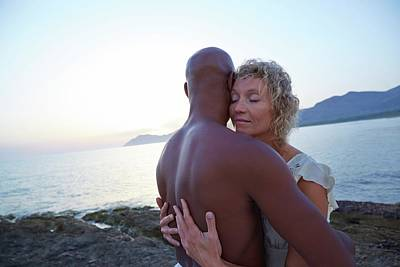 African American Couple Photograph - Couple Embracing On The Beach by Ruth Jenkinson