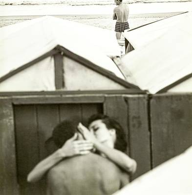 Photograph - Couple Kissing By A Model Wearing Westwood Trunks by Chadwick Hall