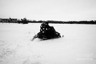 Sask Photograph - couple on a snowmobile going cross country Kamsack Saskatchewan Canada by Joe Fox