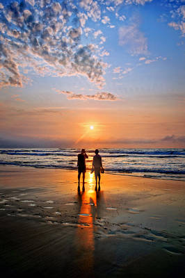 Couple On Beach At Sunset Art Print by Mikel Martinez de Osaba