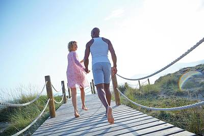 African American Couple Photograph - Couple On Boardwalk On Holiday by Ruth Jenkinson