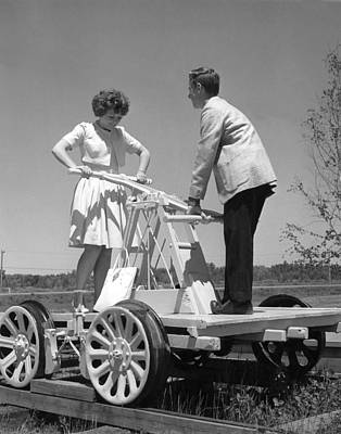 Women Together Photograph - Couple Powers A Railroad Cart by Underwood Archives