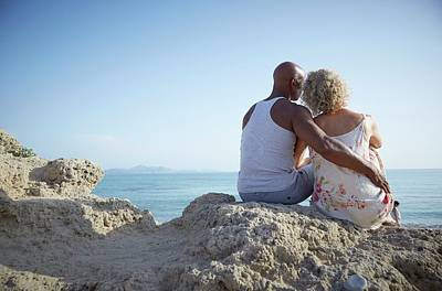 Peaceful Scene Photograph - Couple Sitting On A Rock by Ruth Jenkinson