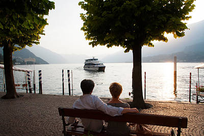 Couple Sitting On Bench And Watching Art Print by Panoramic Images
