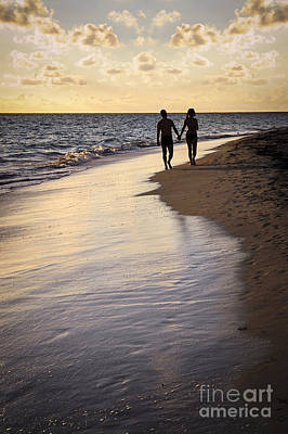 Couple Walking On A Beach Art Print by Elena Elisseeva