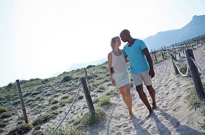 Couple Walking On Sand On Holiday Art Print