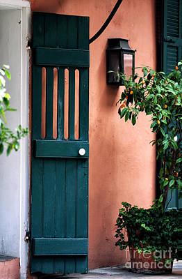 Photograph - Courtyard Door by John Rizzuto