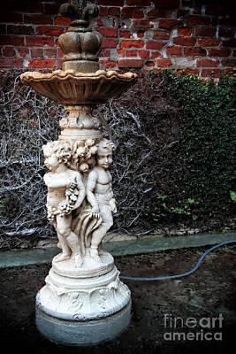 Photograph - Courtyard Fountain by John Rizzuto