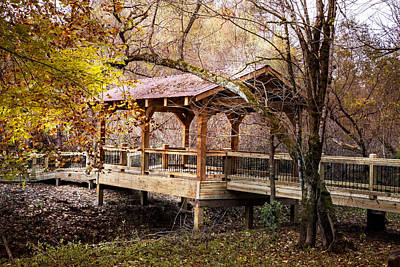 Covered Bridge On The River Walk Art Print by Debra and Dave Vanderlaan
