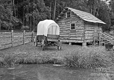 Photograph - Covered Wagon Near Log Cabin Black And White by Valerie Garner