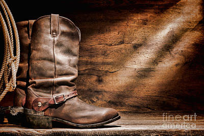 Lariat Photograph - Cowboy Boots On Wood Floor by Olivier Le Queinec