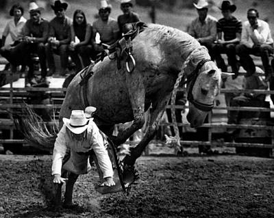 Cowboy Hat Photograph - Cowboy Gets Bucked Off by Retro Images Archive
