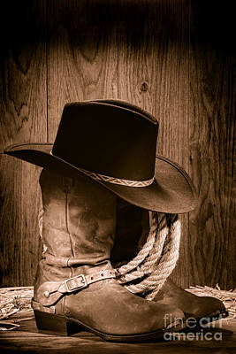 Print Photograph - Cowboy Hat And Boots by Olivier Le Queinec