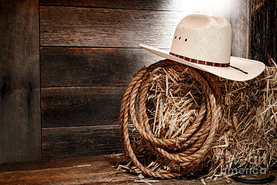 Bale Photograph - Cowboy Hat On Hay Bale by Olivier Le Queinec