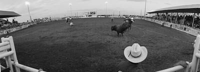 Cowboy Riding Bull At Rodeo Arena Art Print by Panoramic Images