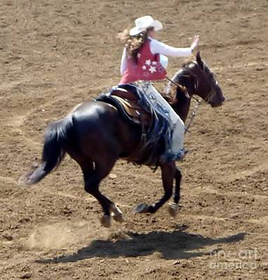 Photograph - Cowgirl And Horse Catch Air by Susan Garren